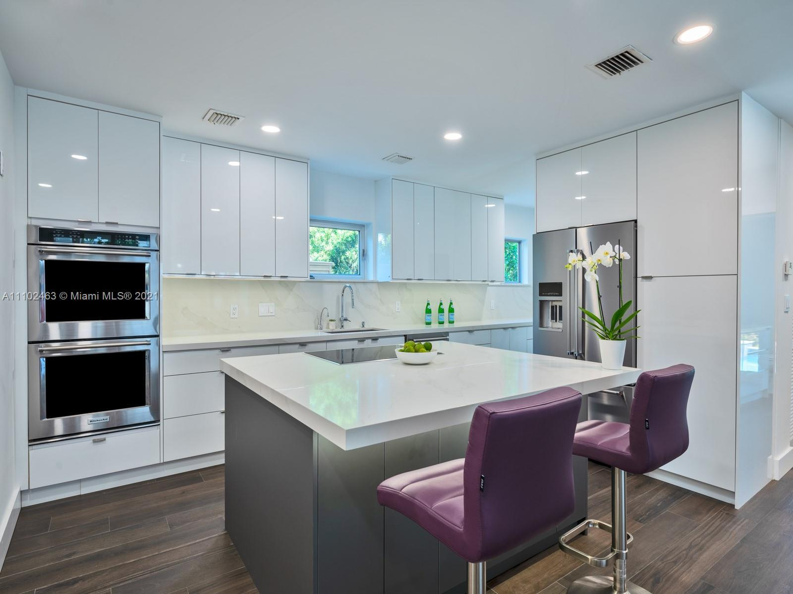 Welcome home to nearly 4,000 sq foot meticulously renovated 1925 Miami Beach residence on prestigiou