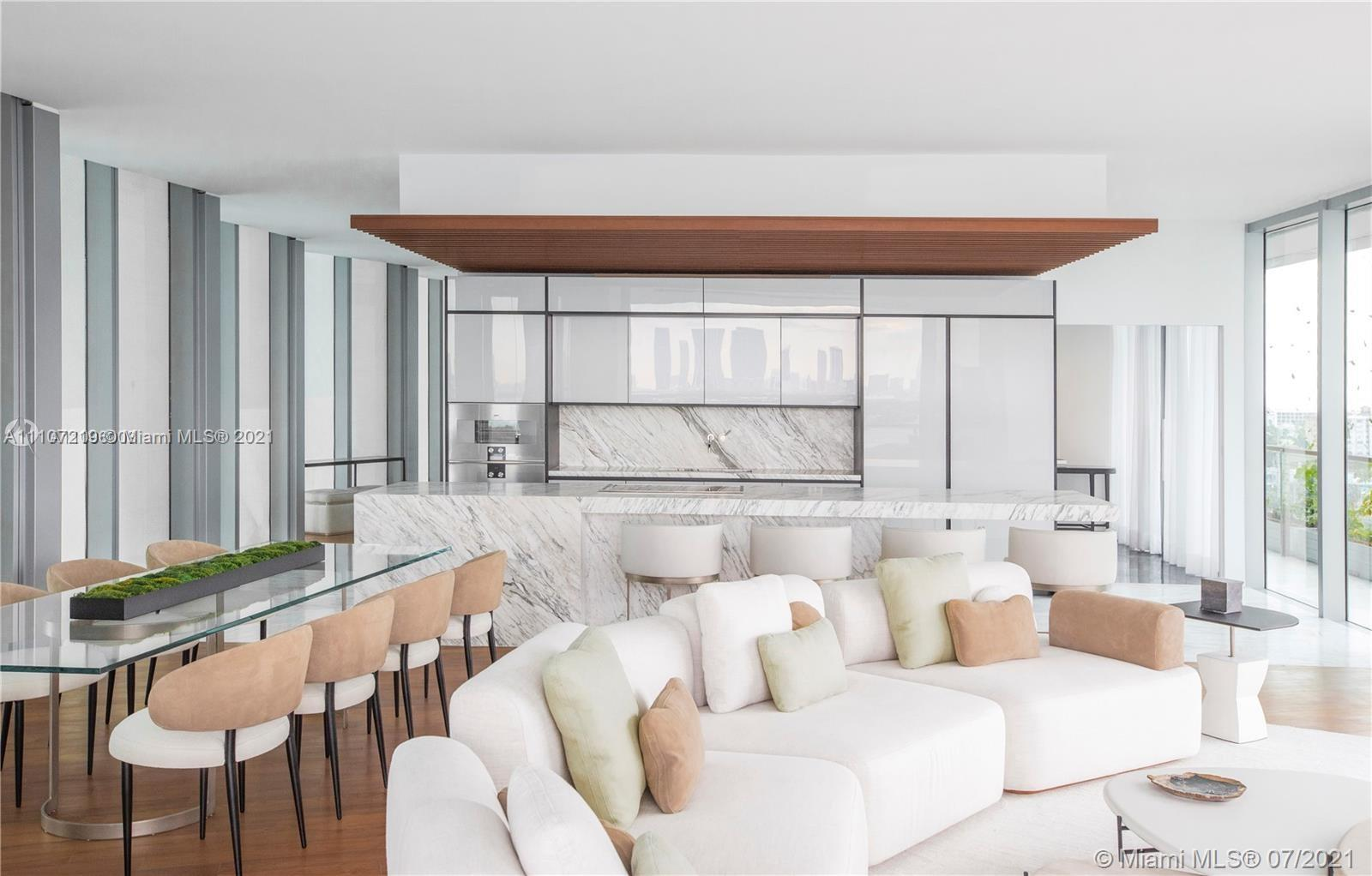 Composed of 59 individually designed waterfront residences around a glittering lagoon, Monad Terrace