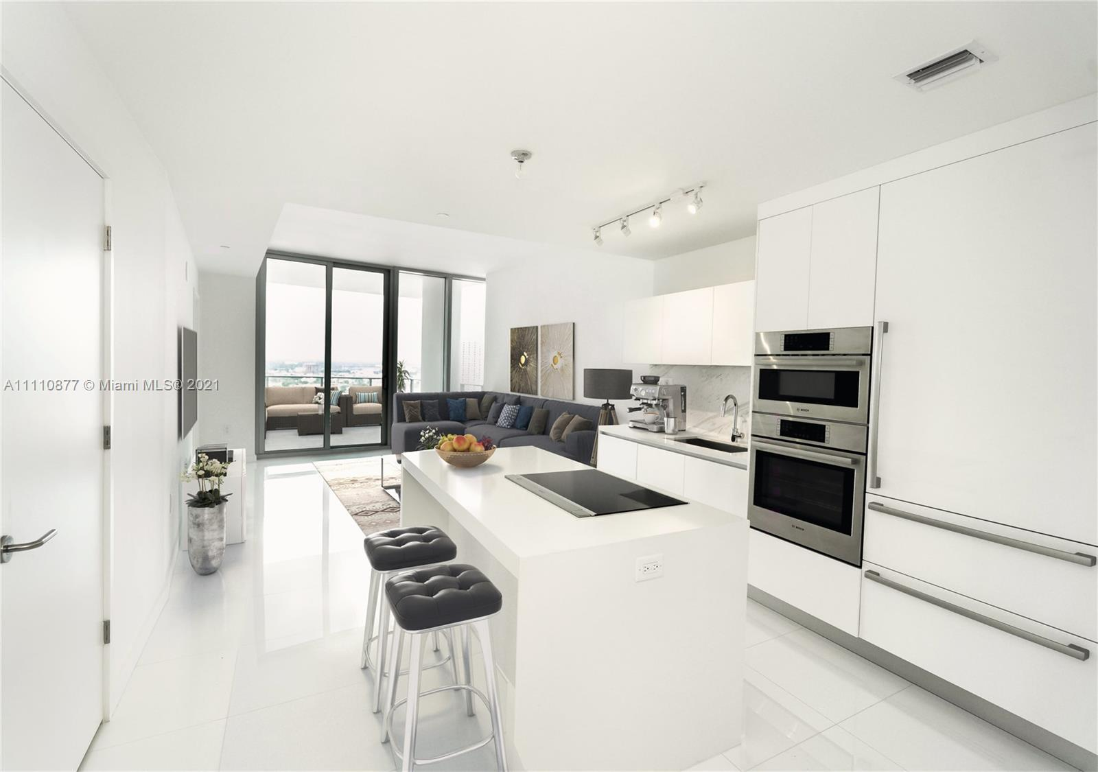 Welcome to the home you never have to leave! Take your private elevator to this sparkling modern uni