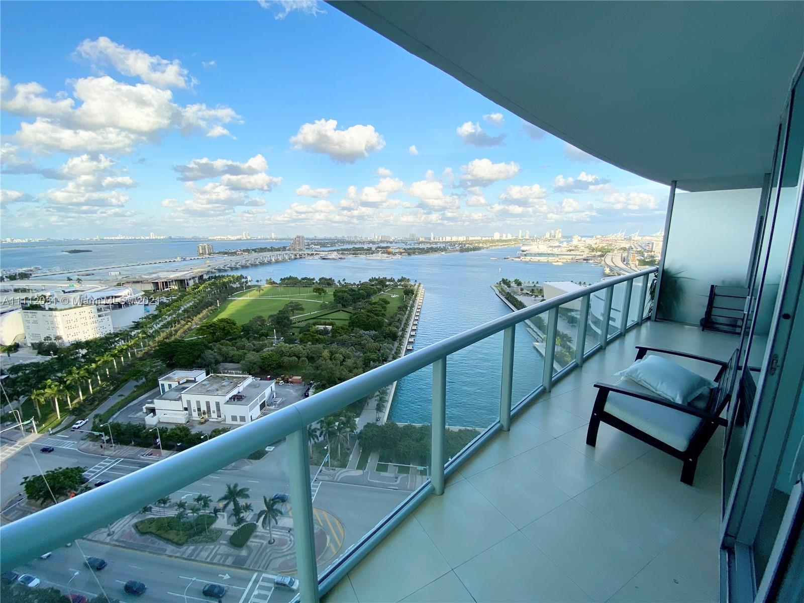 Spectacular Corner Unit at Marina Blue with 2 Parking Spaces plus 1 Storage Space. Features include