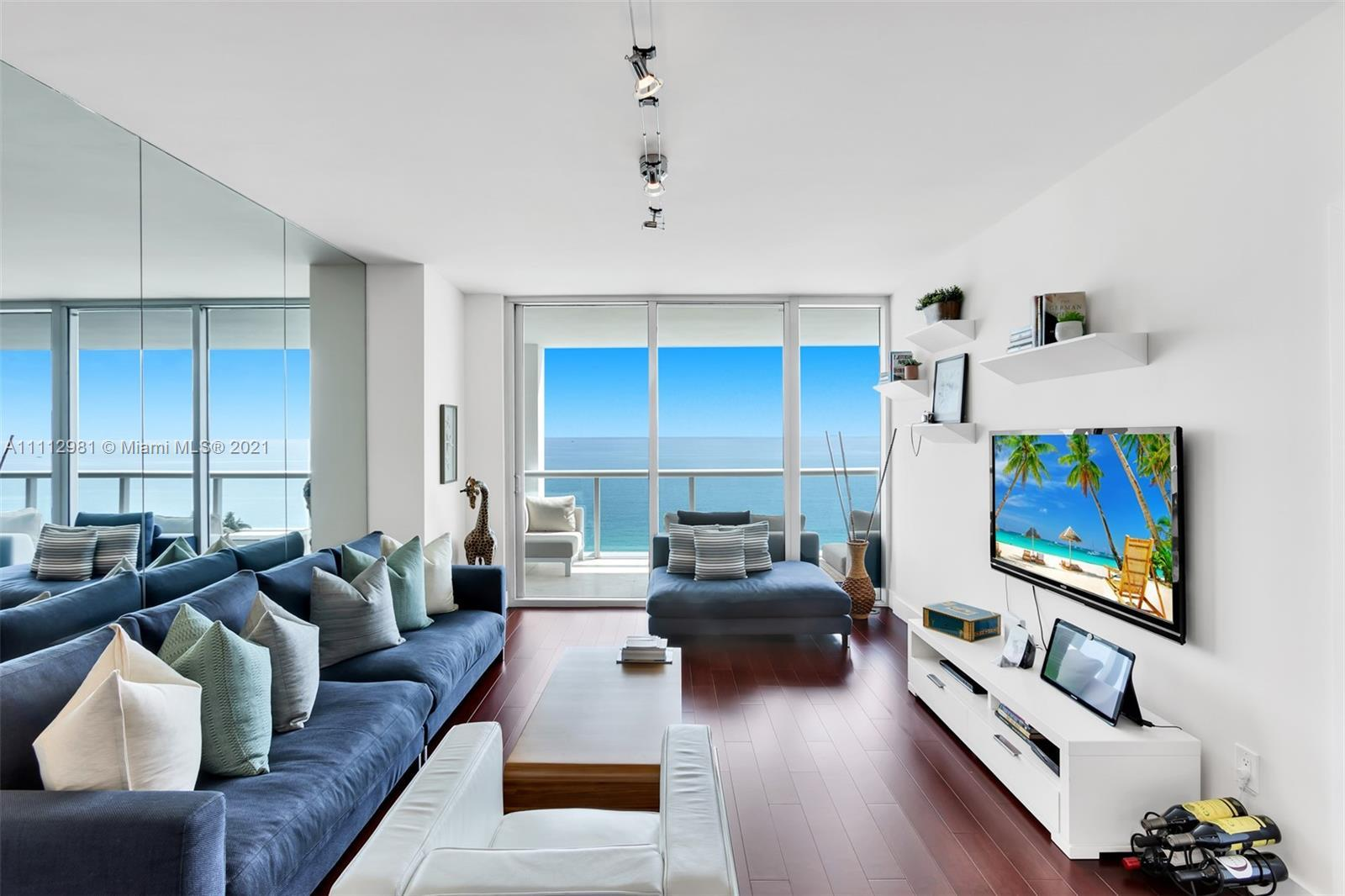 DIRECT OCEAN views from every room on this exquisite 2bd/2ba + a large direct ocean balcony on a hig
