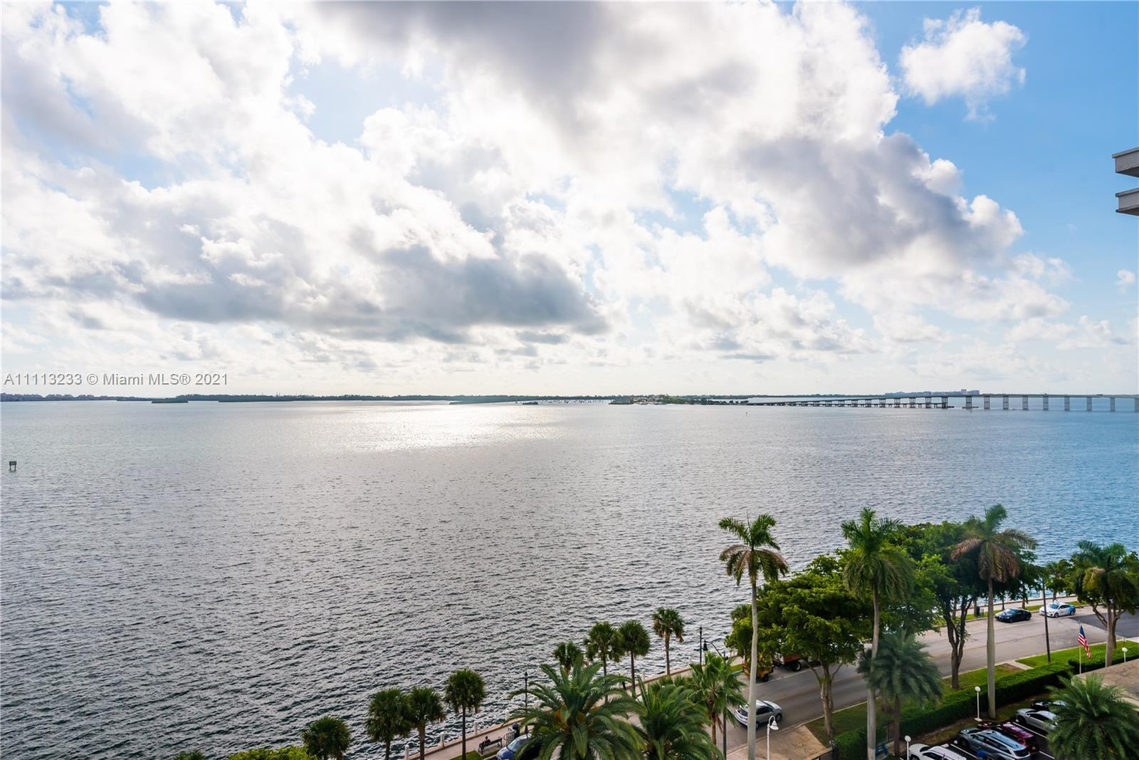 This spectacular two story 2/2.5 on Brickell Bay Drive is in an amazing location within walking dist