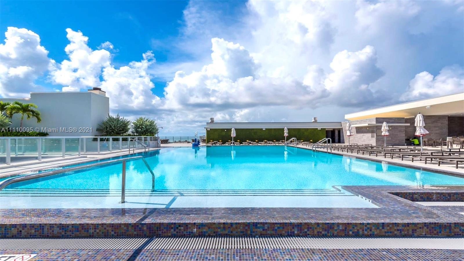 Modern 1 bedroom plus 1 den with 1 bath, all fully furnished on the famous Hollywood Beach boardwalk
