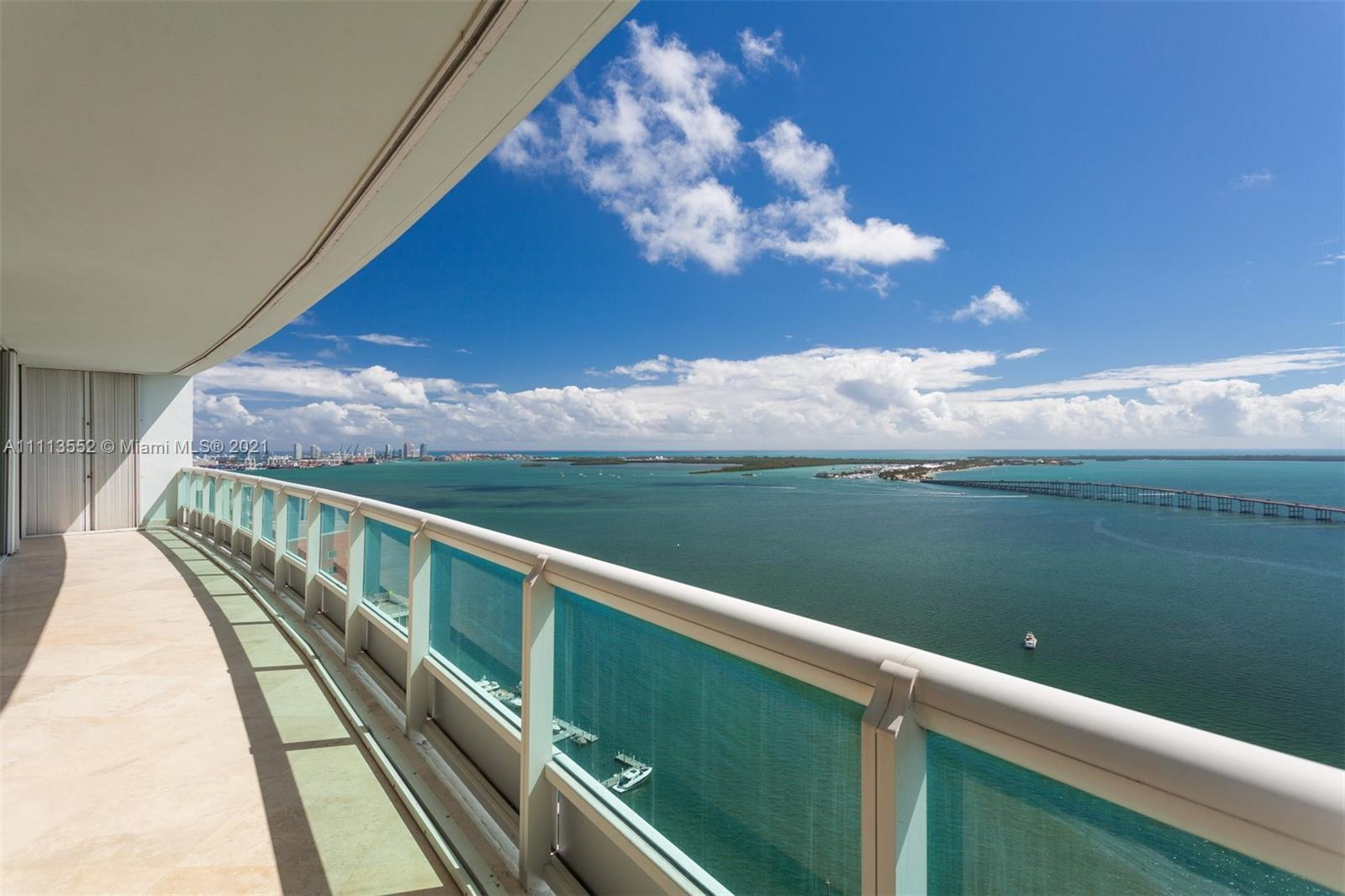 HIGH IN THE SKY, THIS IMPECCABLE FLOW-THROUGH RESIDENCE ON THE 35TH FLOOR OFFERS OCEAN AND CITY SKYL