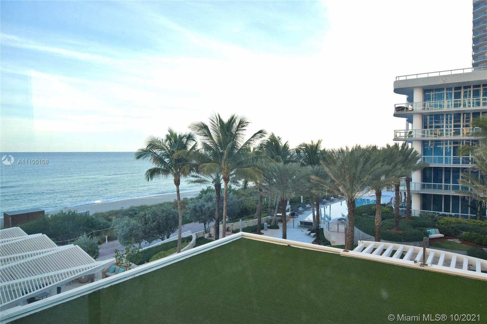 Carillon Hotel & Spa , a premier oceanfront resort. Ocean & Palm Court views from floor-to-ceiling w
