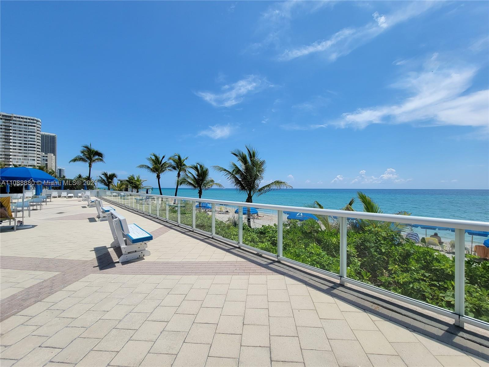 MUST SEE! ~~ COME FALL IN LOVE WITH THIS OCEANFRONT HOME.  ENJOY OCEAN BREEZES & SOME OCEAN VIEWS.