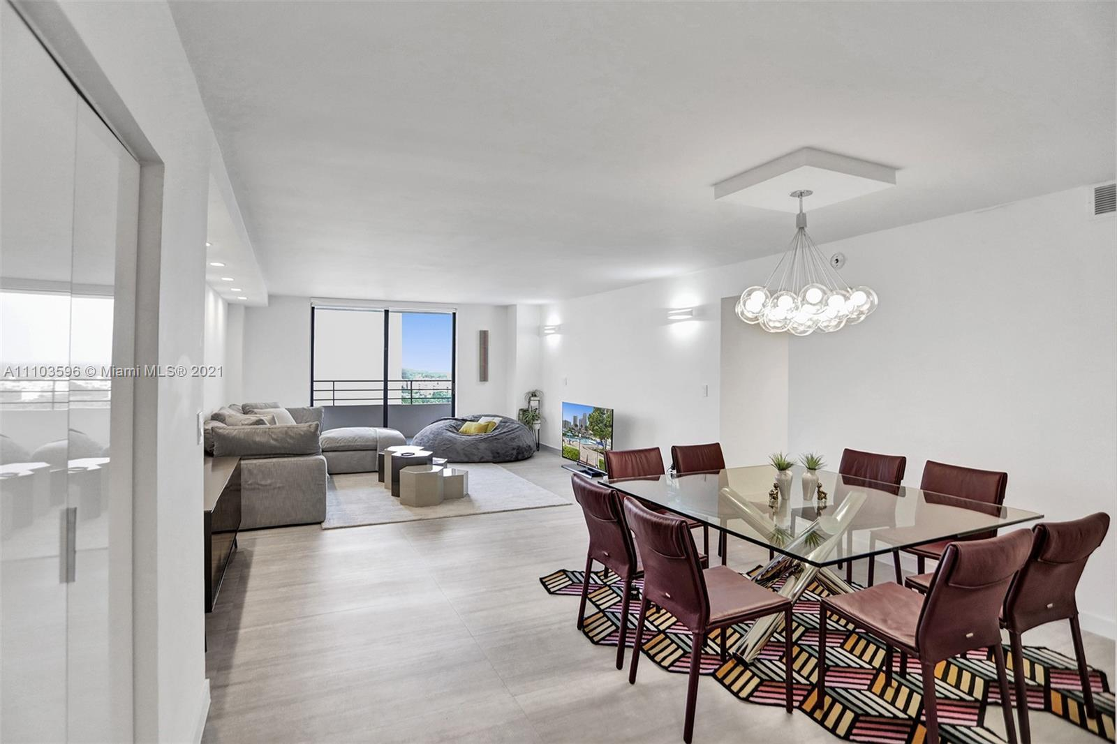 MOVE IN WITH YOUR TOOTHBRUSH! HIGHLY DESIRED COMPLETELY REMODELED 2bed/2bath CORNER UNIT WITH TOP OF