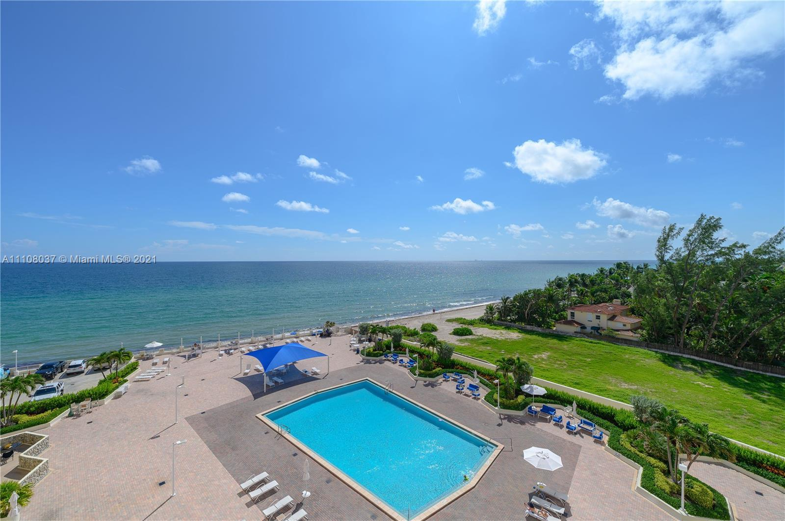 The ocean is calling and you must go. Welcome to this spacious 2 bed/2 bath condo directly in front