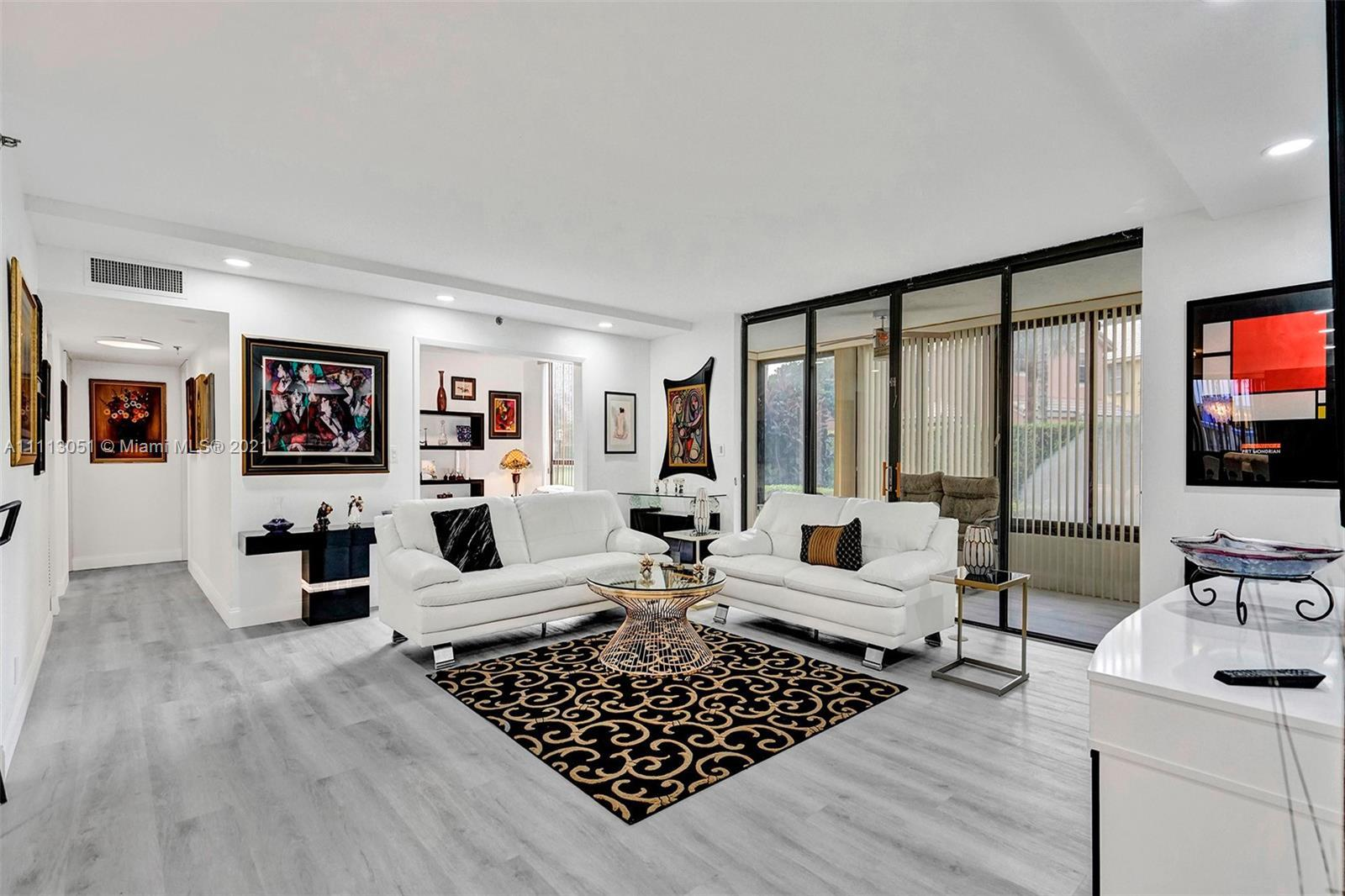 Wow! Fantastic modern residence in Boca Pointe. Like a home w/ all the amenities of a condo. Walk ri
