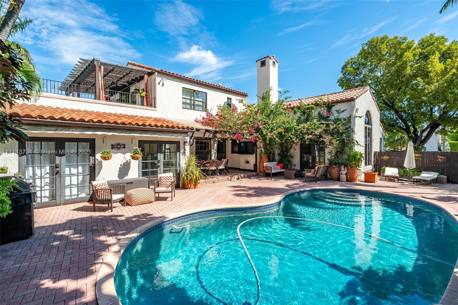 European elegance meets modern tropical living. Historic, exquisitely restored Mediterranean Revival