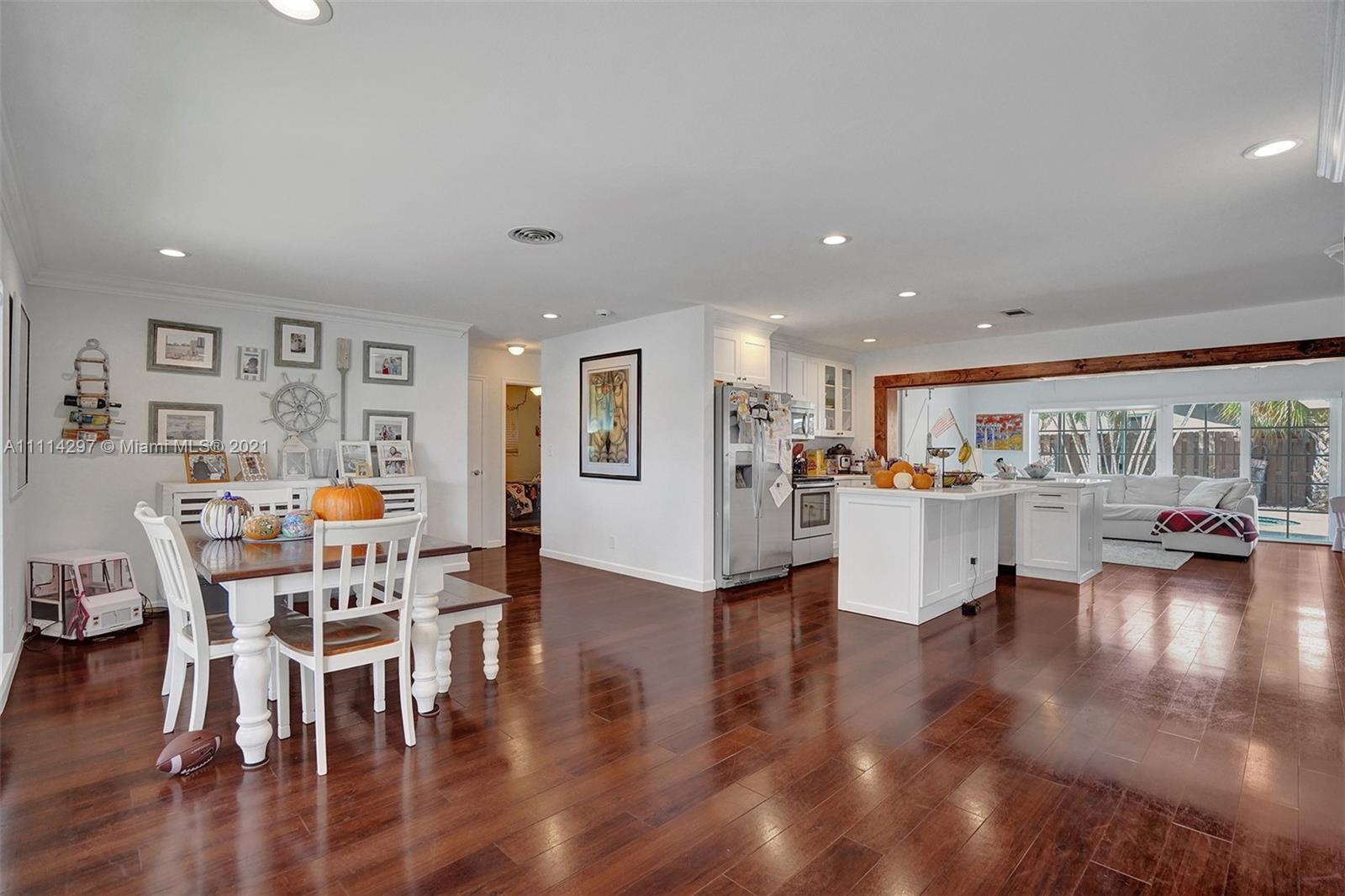 Location! Completely remodeled 4 bed 3 bath home with sparkling pool & beautifully landscaped yard i