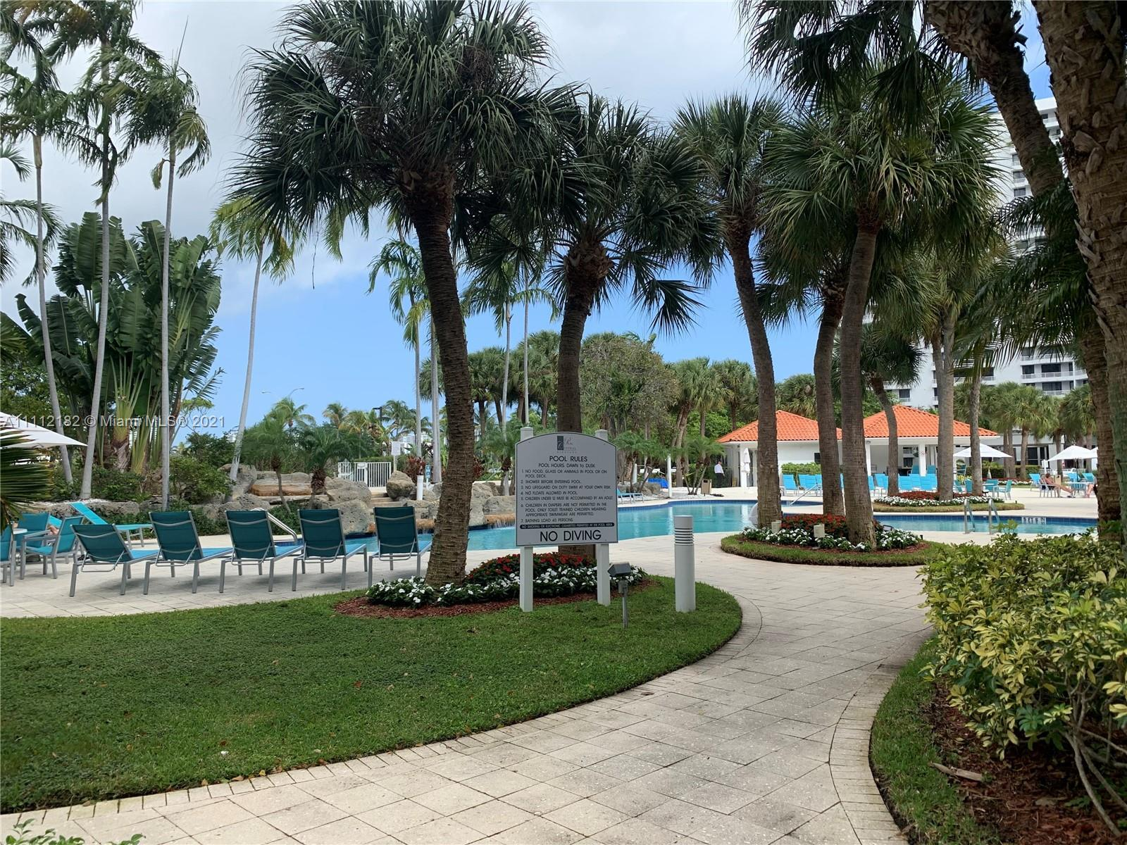 Best line in the building..... Beautiful peaceful views of pool and inter- coastal, golf and lake vi