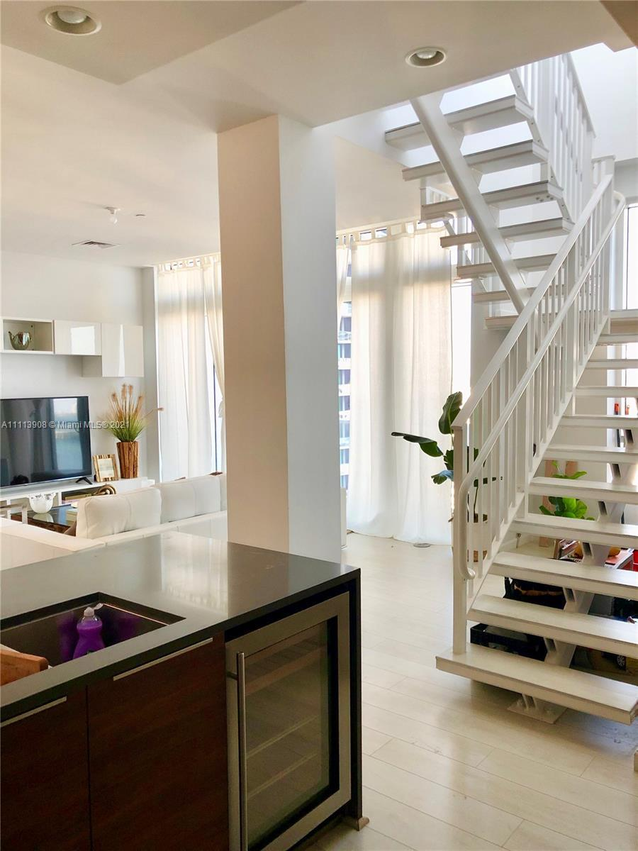 One of a kind penthouse with private jacuzzi in Edgewater District.  Bay views from open terrace abs