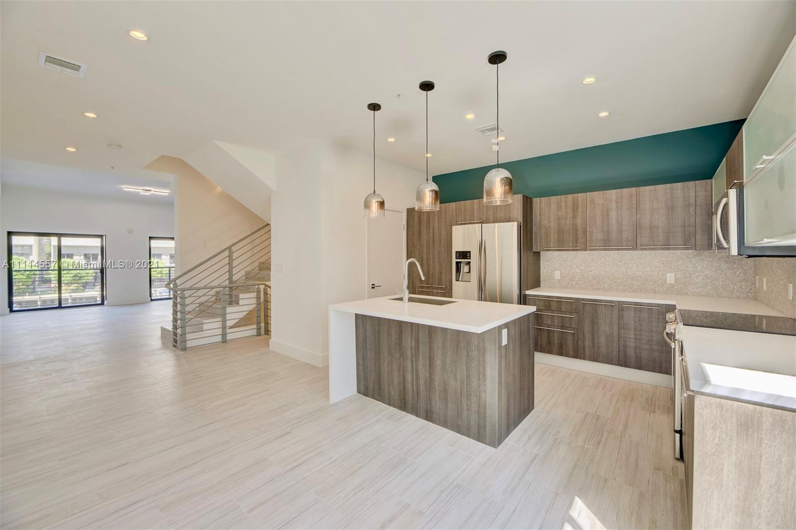 STYLISH & SPACIOUS NEW  4 STORY 3 BED 2.5BATH TOWNHOUSE FACING THE MARINA IN DESIRABLE KOI RESIDENCE