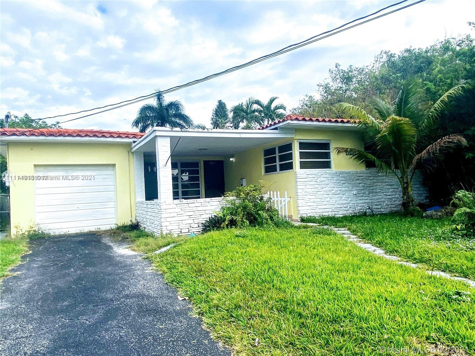 A rarity in Surfside 4 bedrooms and 3 baths. The enormous family room could be easily coveretd to a