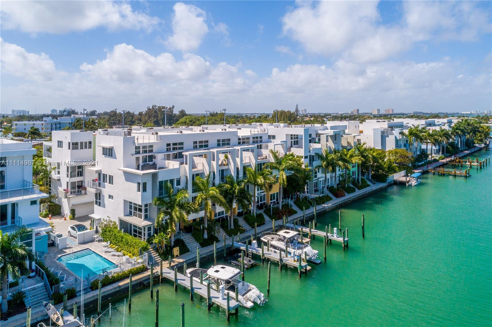 Live the Miami dream in this beautiful 4 story waterfront townhouse. Located in Iris On The Bay feat