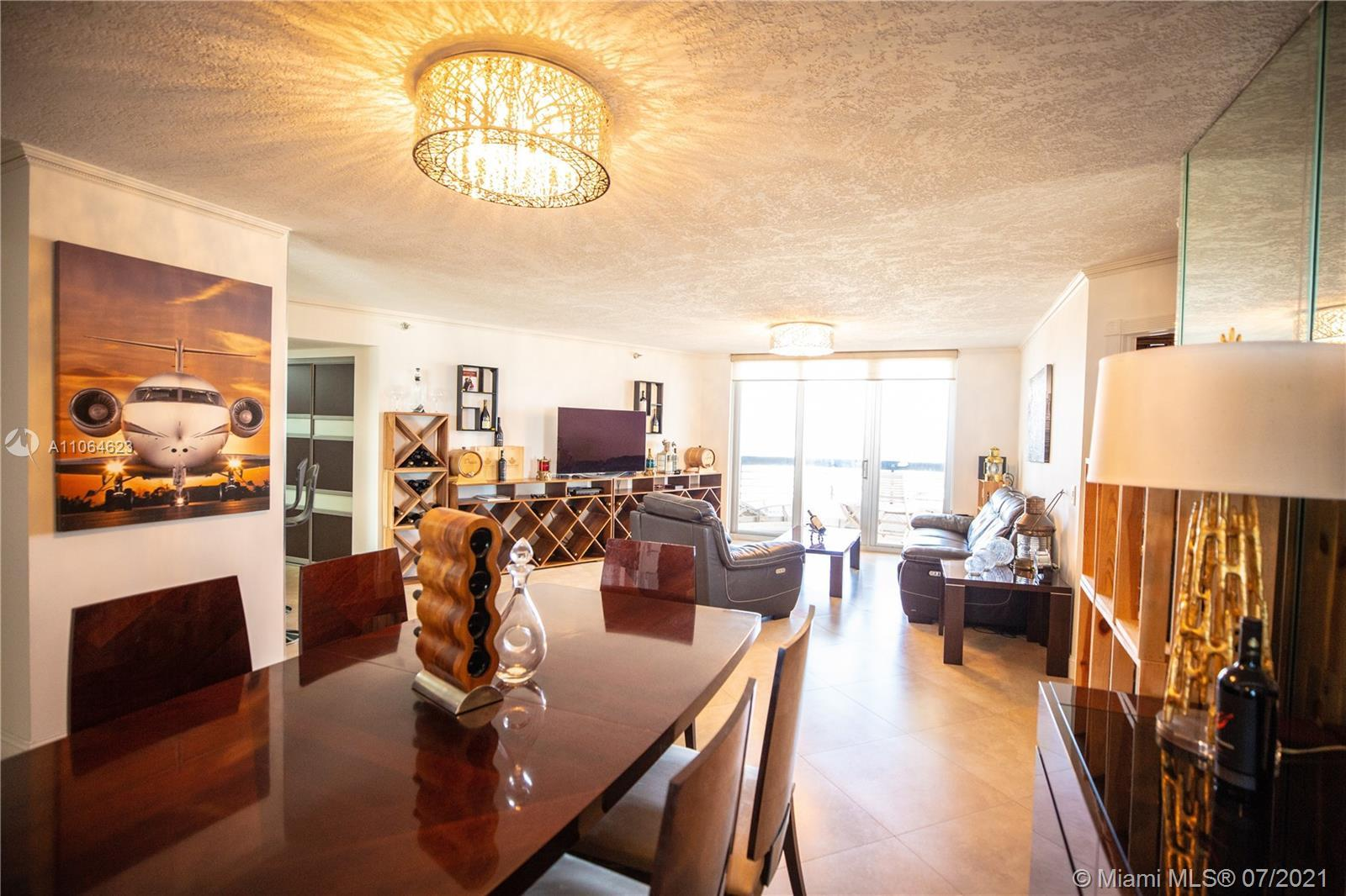 One of a kind! Enjoy amazing views of ocean, intracoastal, marina and the skyline from this spacious