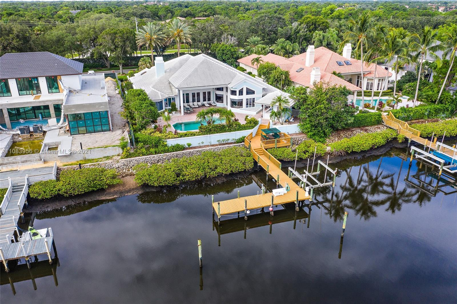 Great Opportunity - This waterfront estate home has 4 bedrooms, 3.5 car garage, open kitchen to fami
