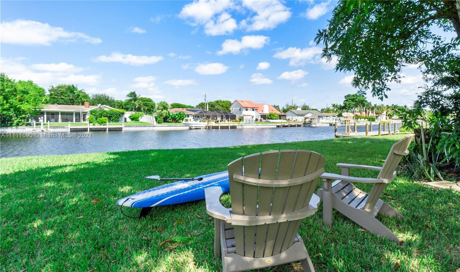 Rare find Waterfront home on the C-15 canal! Launch your Kayak/Paddleboard from the convenience of y
