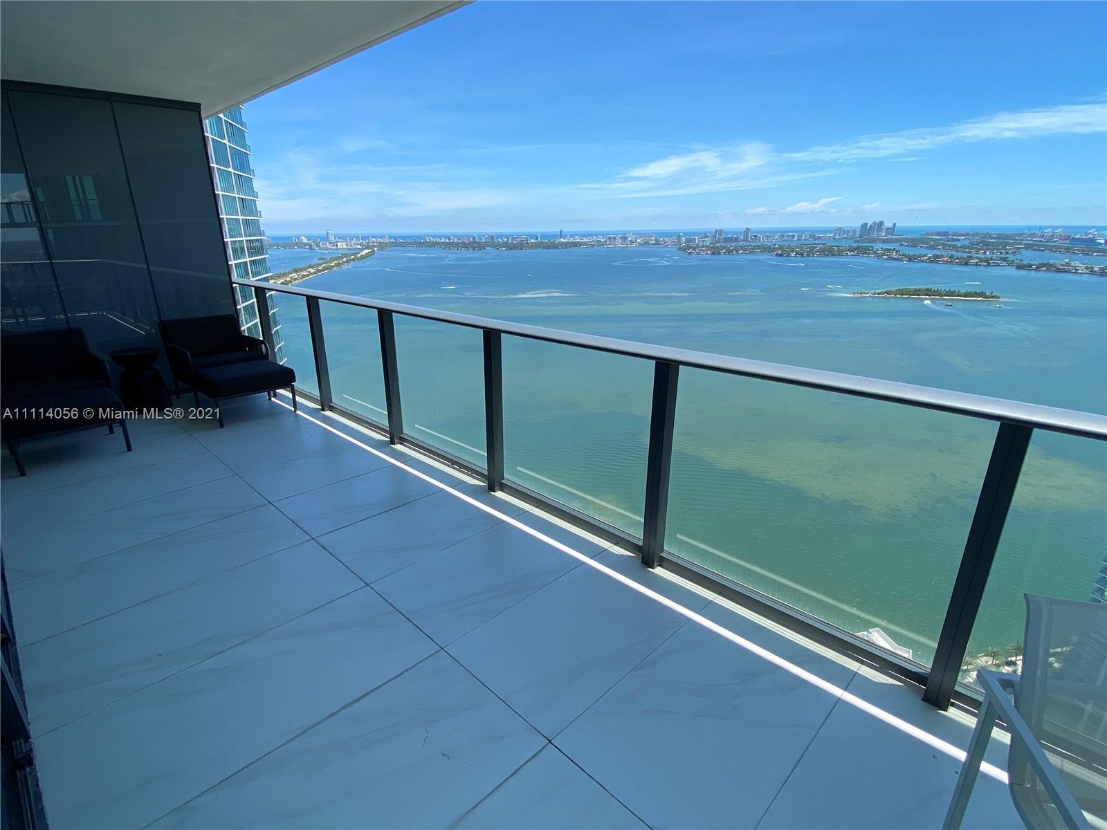 Breathtaking views from the 46th floor, corner unit with east and west views and floor to ceiling wi