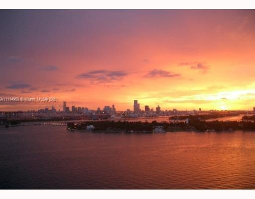 Beautiful unit overlooking the bay, fisher island, and the sunset over downtown Miami. Tile floors.