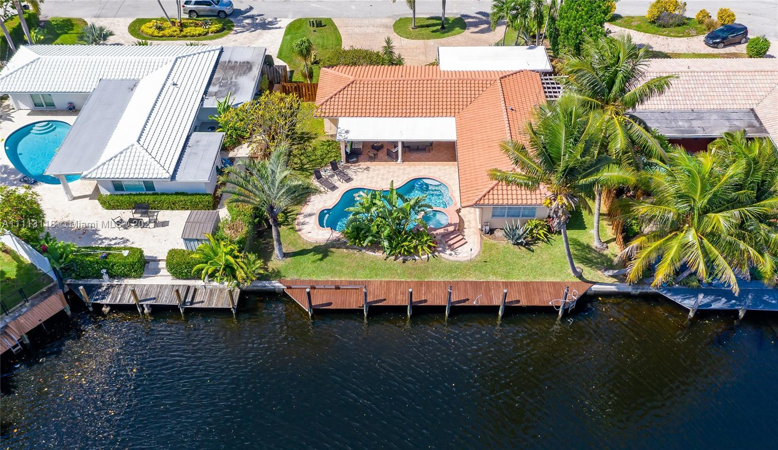 Stunning Waterfront home 3BR/2BA with Ocean access. Private 75'dock with davits, electricity and lig