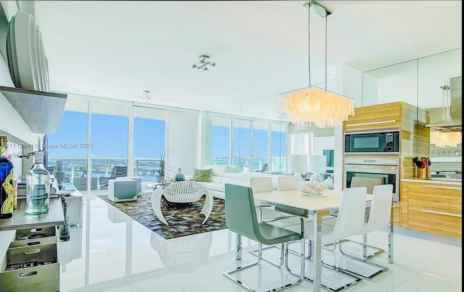 THIS GORGEOUS 1 BEDROOM &DEN CONVERTED INTO 2ND BEDROOM/2.5 BATH CONDO IS FULLY FURNISHED BY ARTEFAC