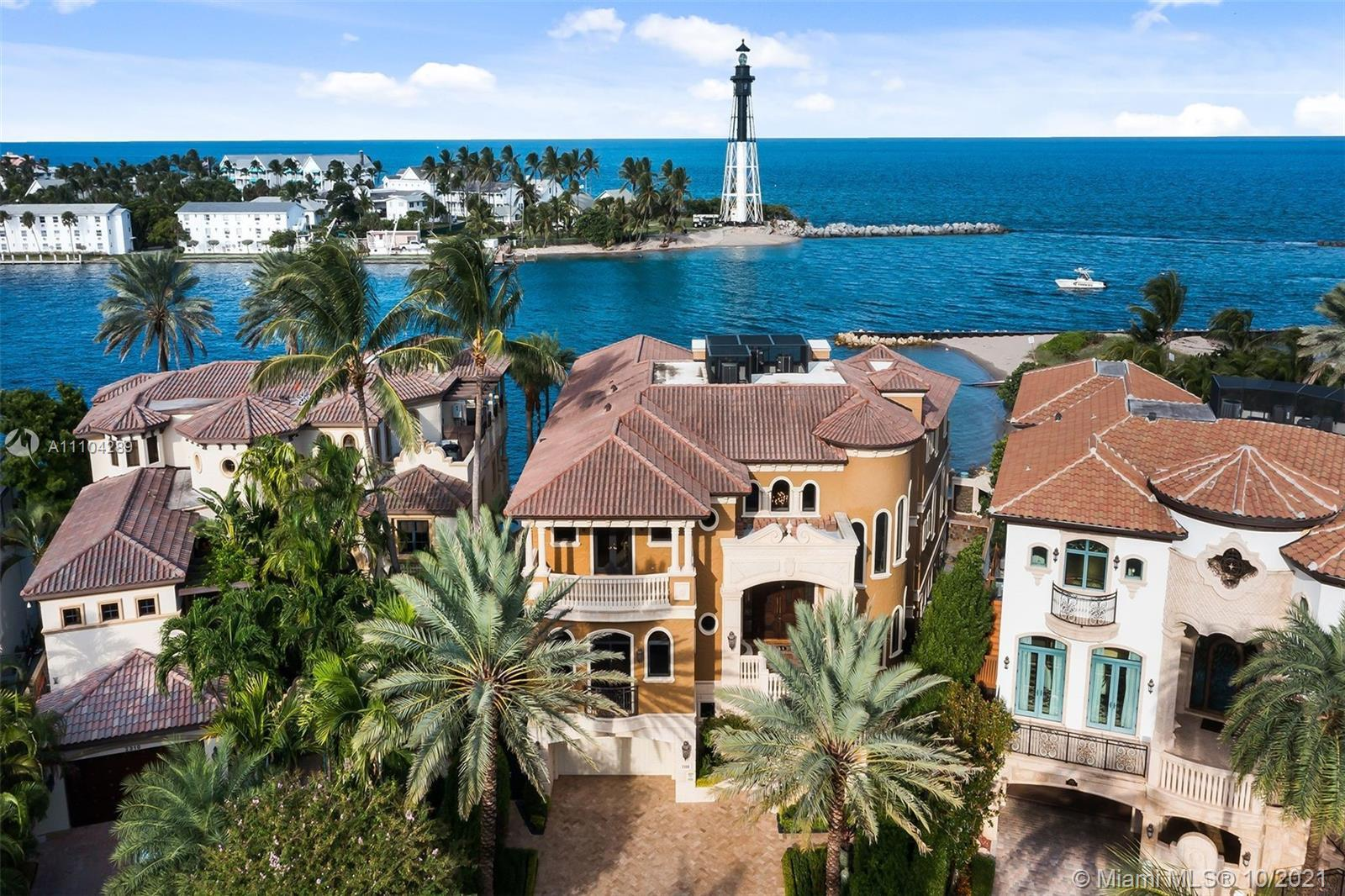 Positioned directly on the Hillsboro Inlet, this unrivaled oceanfront estate encompasses 127' feet o