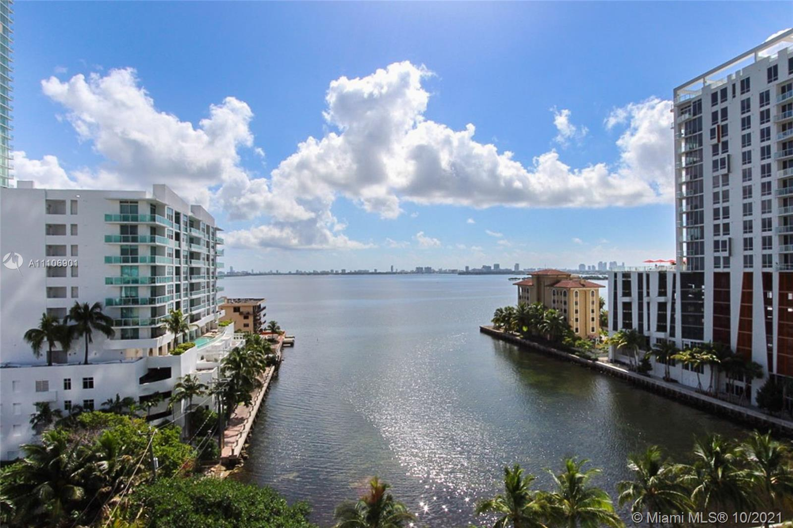 Beautiful corner unit with amazing bay views, filled with natural light! Spacious 2 bedroom + den re