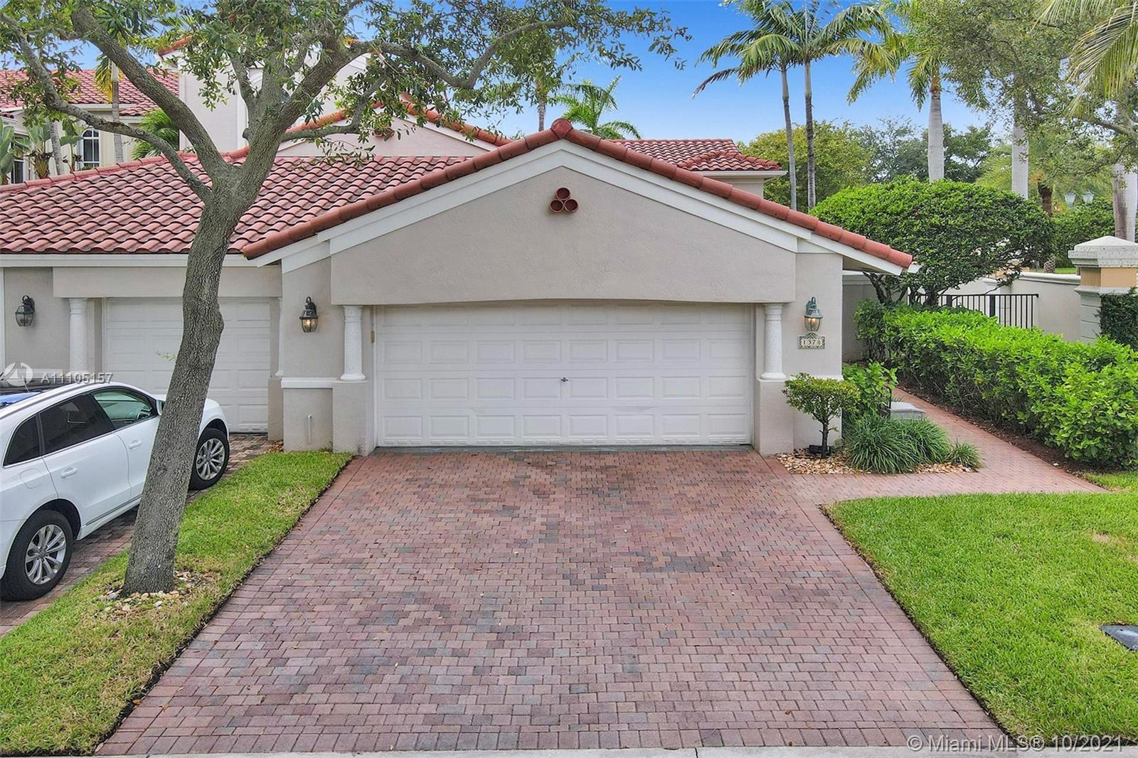 One-story corner townhome in popular guard-gated Harbor Islands is immaculate, bright and spacious w