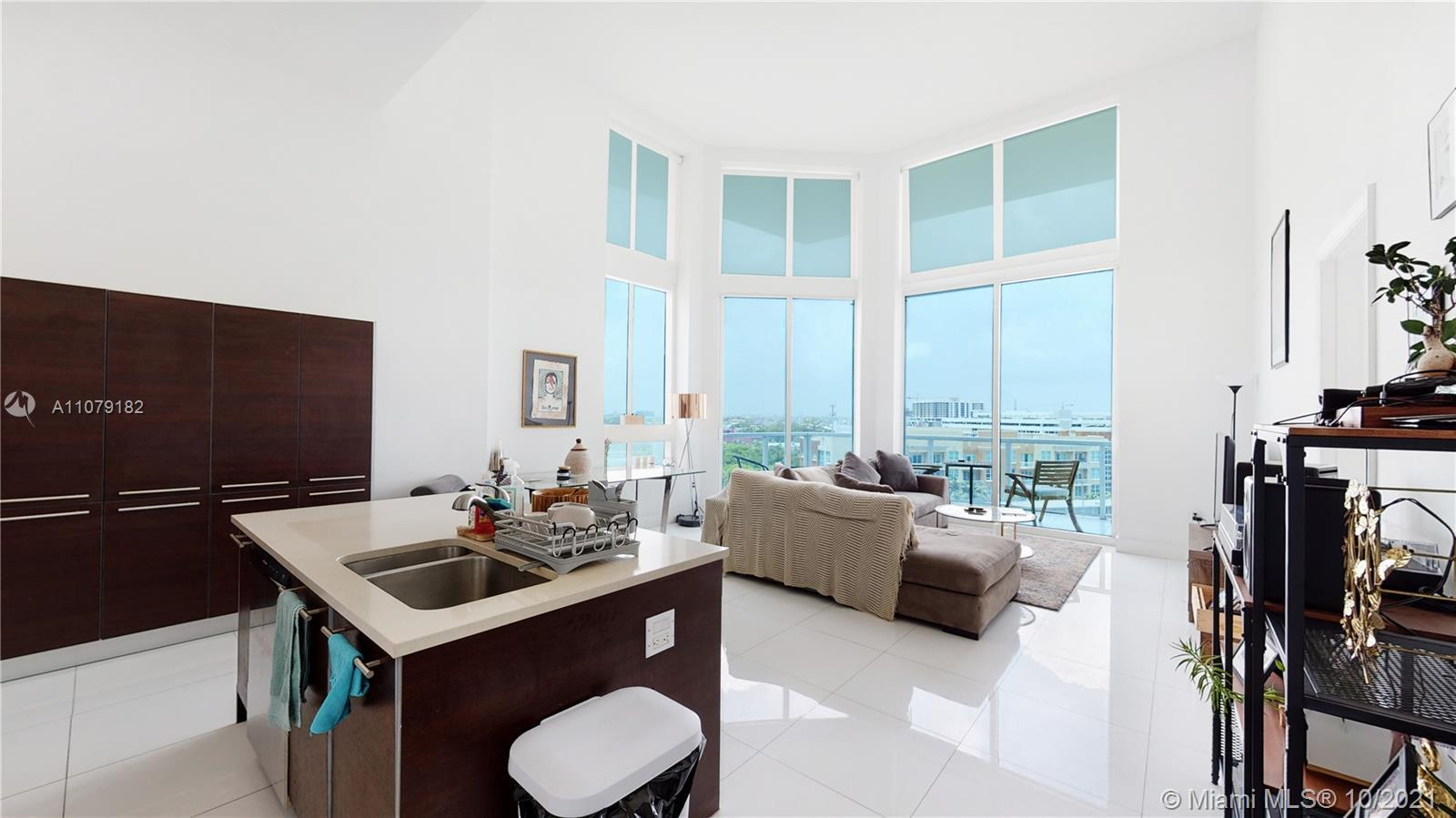 Come see this marvelous 2/2.5 bath unit at Quantum on the Bay with lots of natural light & open conc