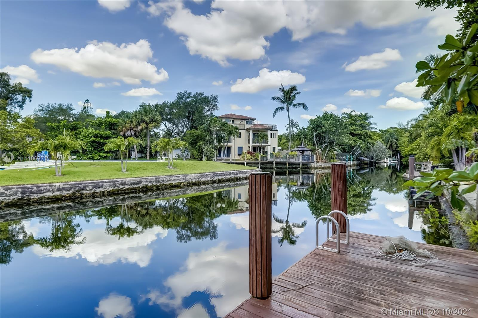 TRANQUIL WATERFRONT LOCATION ON THE TARPON RIVER.  Four bedroom, three bath, single family home situ