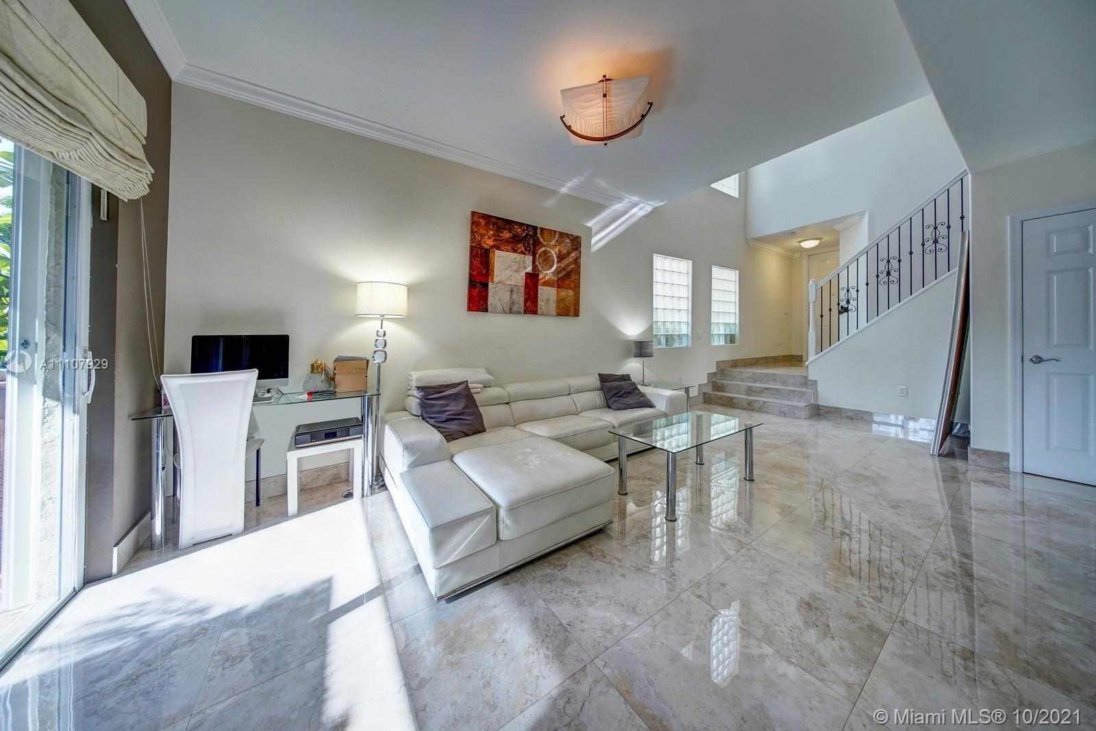 Beautiful 4 Bedroom, 2.5 bath single family home in Aventura Lakes. This home boasts marble and wood