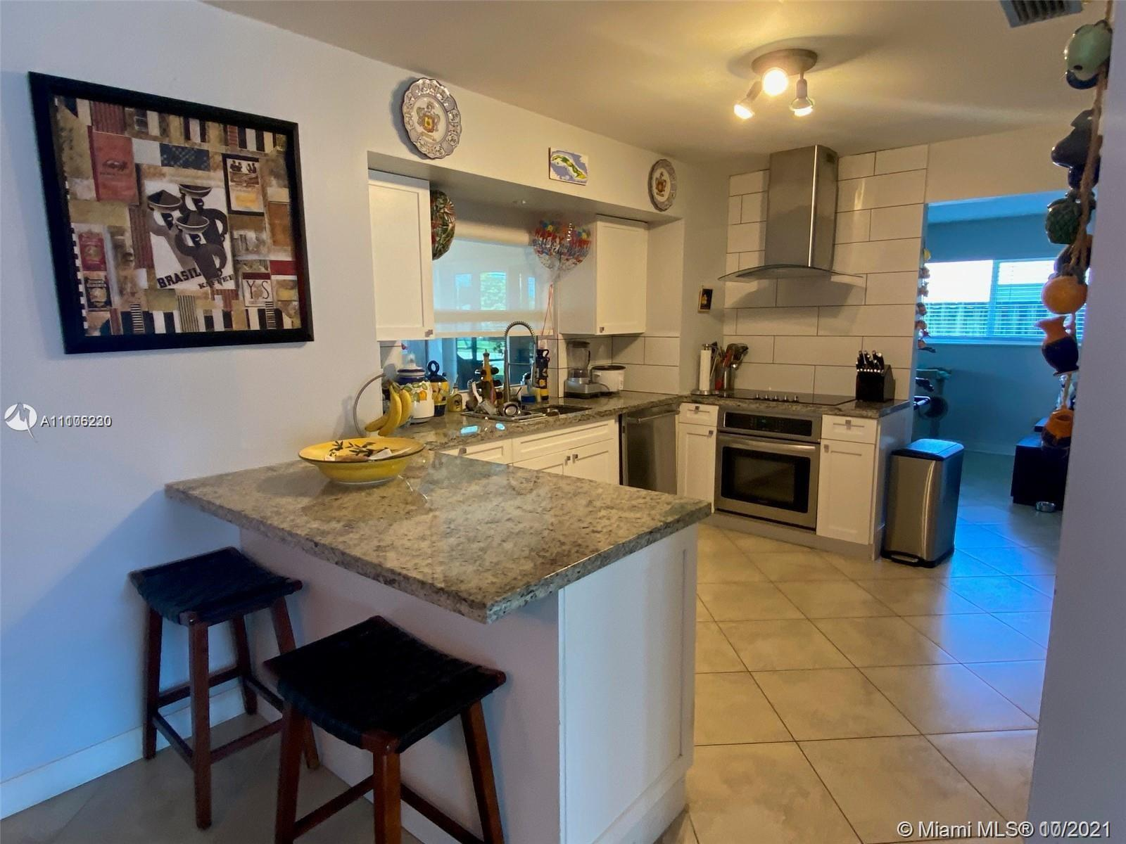 HOLLYWOOD HILLS - CORNER LOT - RENOVATED 3 BEDROOM 2 BATH + HUGE FAMILY ROOM AND TREMENDOUS SCREEN R