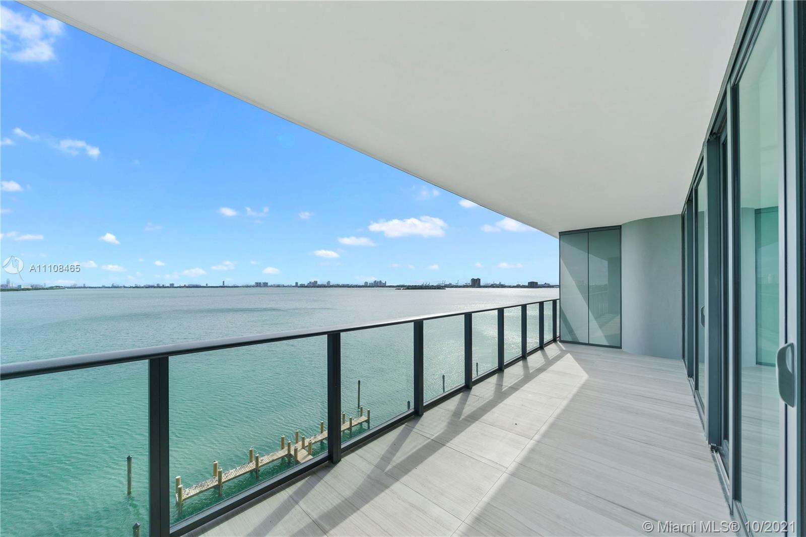 Spectacular BAYFRONT UNIT @ ONE PARAISO. 3 beds, 3.5 baths + den with private elevator to unit. Unit