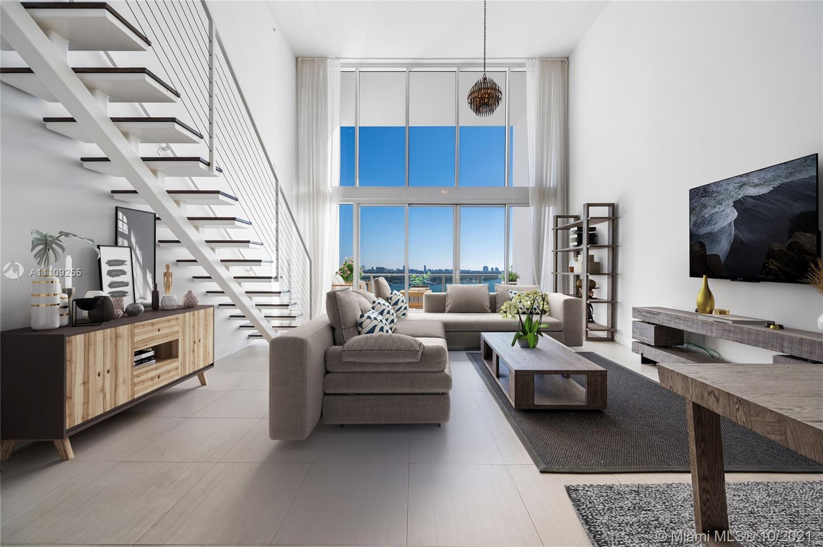 Welcome to Ten Museum Park by Oppenheim Architecture. This Two-Story Waterfront Loft has two bedroom