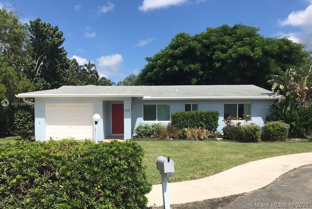 This captivating 2 bedroom, 2 bathroom home prominently sits on a cul-de-sac street in East Boca. As