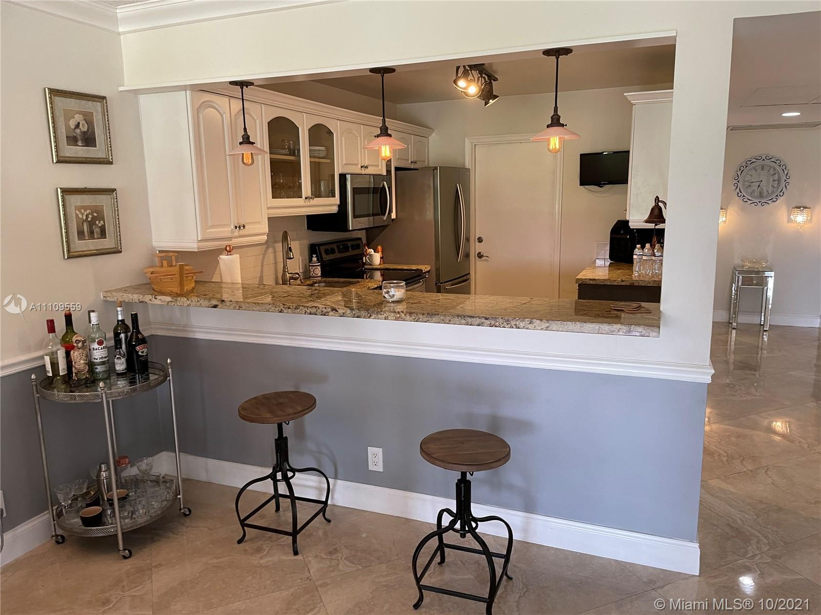 *Beautiful Corner Unit**Remodeled**Stainless Steel Appliances**Golf Views*Needs to complete Master B