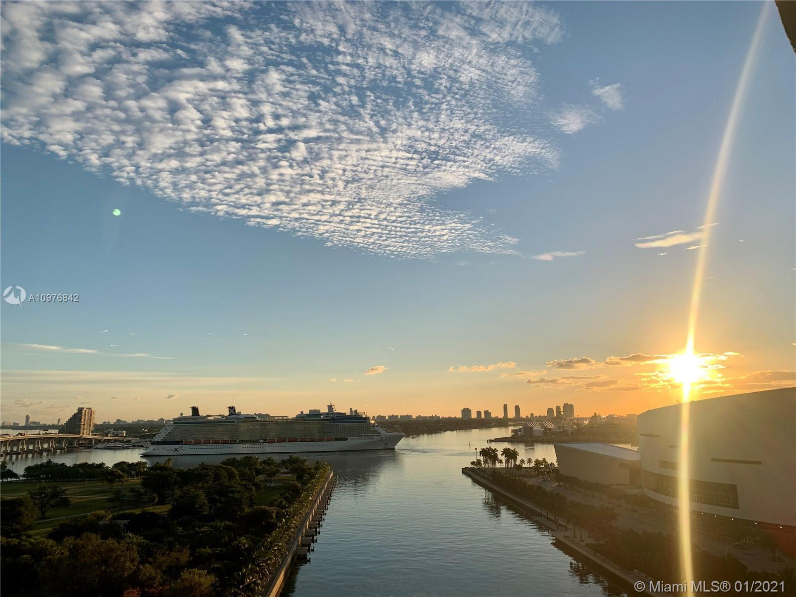 Extra high ceilings corner condo delivering stunning sunrise views and partial sunsets. The floor to