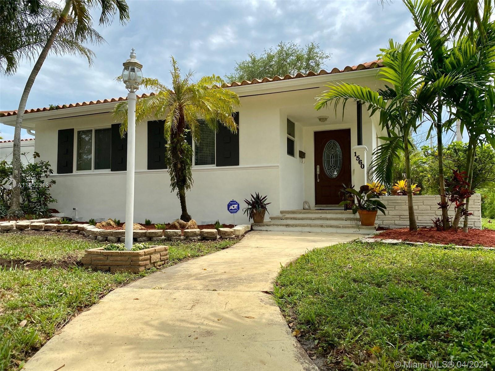 Centrally located three-bedroom two-bathroom Coral Gables home just blocks away from Saint Theresa C
