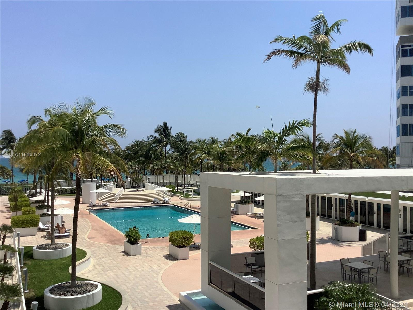 Spectacular direct ocean, beach, and pool view from this spacious 2 bedroom/2 bathroom apartment wit