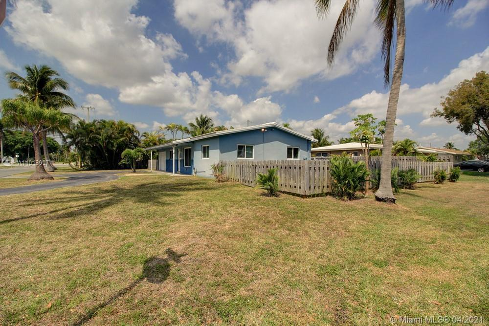 Lovely 3 bedroom, 2 bathroom single family home located on a large corner lot with a pool in highly