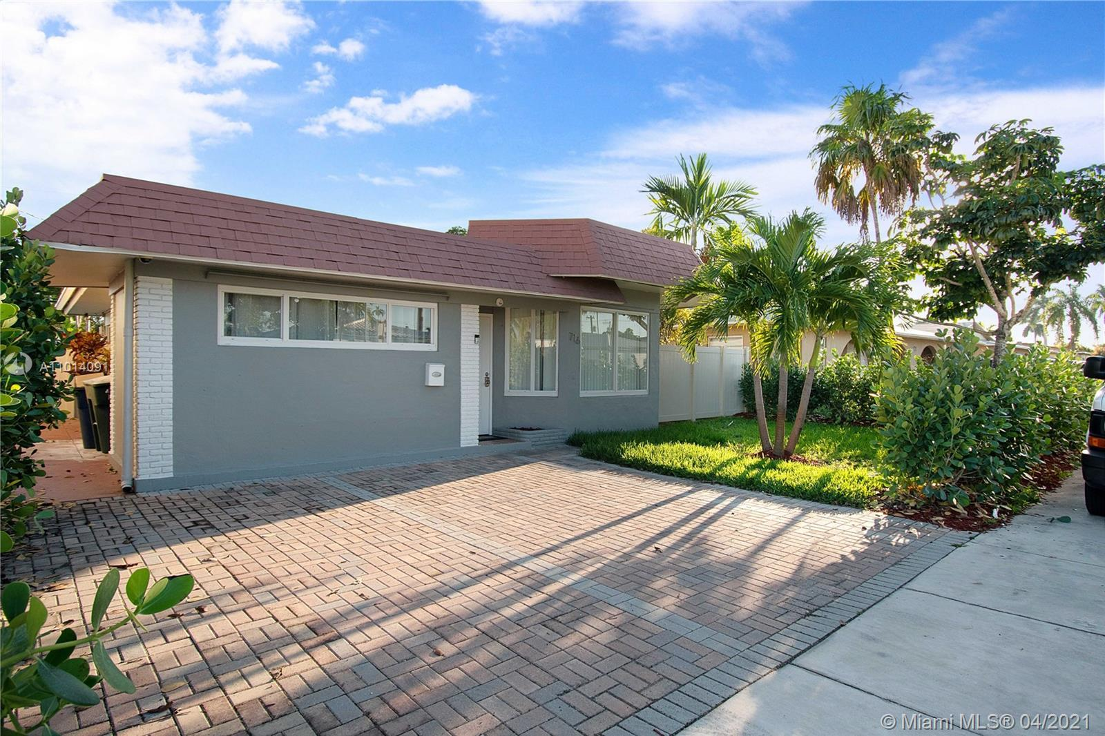 Wonderfully appointed 5 Bedroom, 3 Bath residence features a lush landscaping, private fence and roo