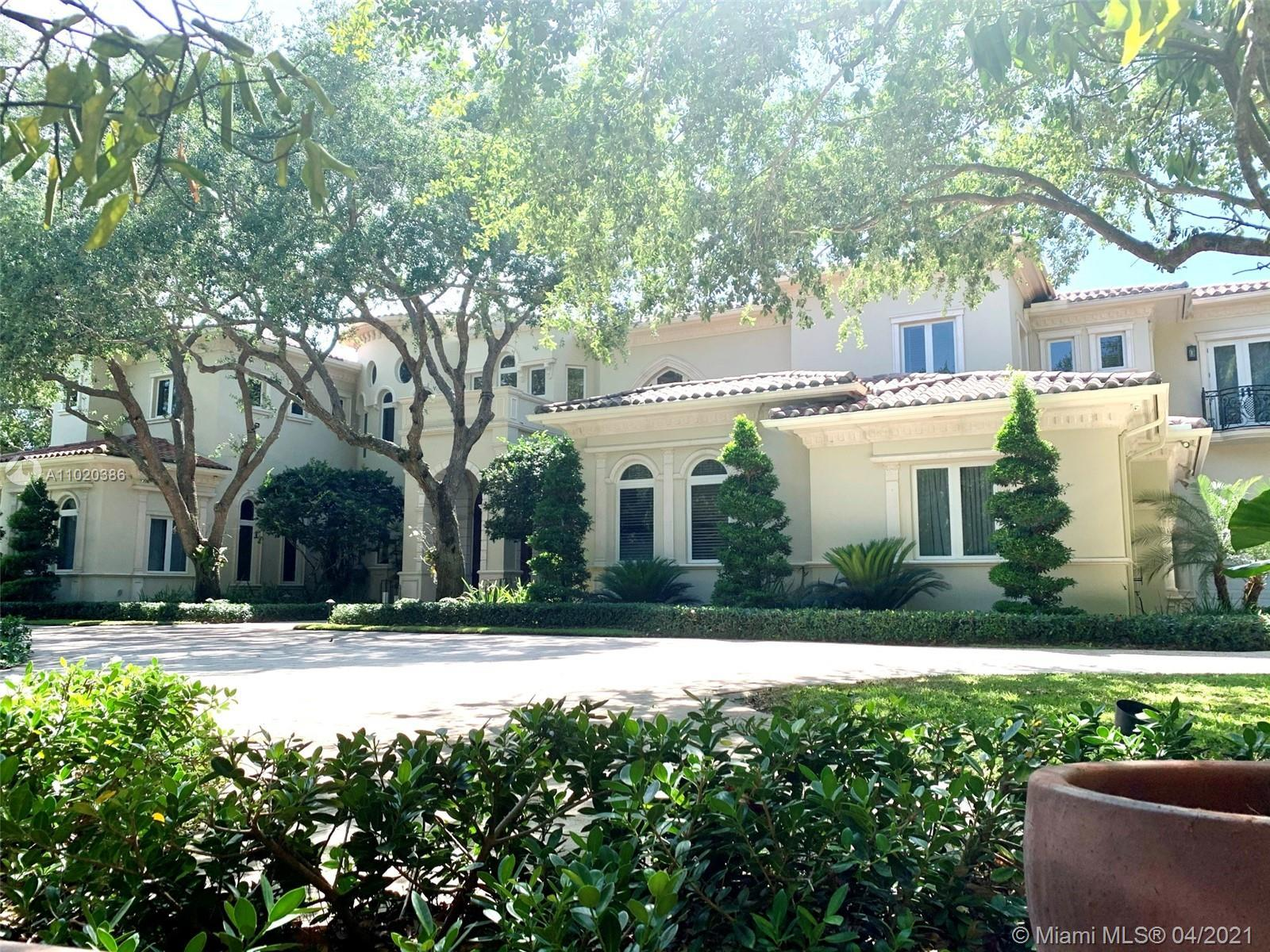 Most sought out after North Pinecrest Palatial Estate located on the exquisite Suburban Drive. 11,91