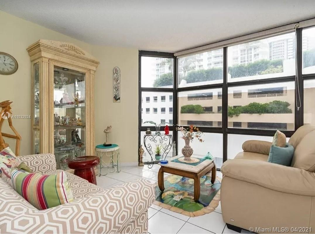 Live on the Beach!!! Spacious 1 bedroom condo plus den, converted to a 2 bedroom. Oversized unit wit
