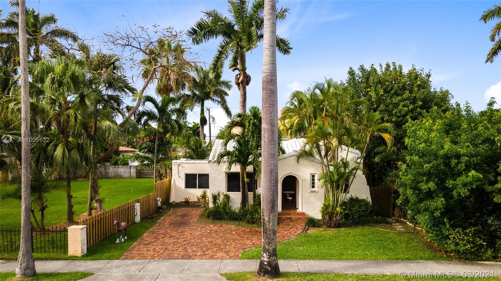 Amazing opportunity to own an original Hollywood Lakes Mediterranean Revival home. Built in 1924 its