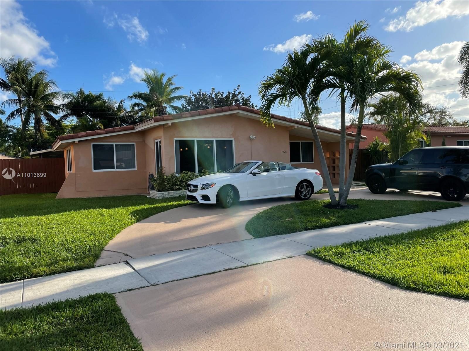 Charming Hallandale house with 3 bedroom + DEN, 2 full bath and large living area.features a lush la