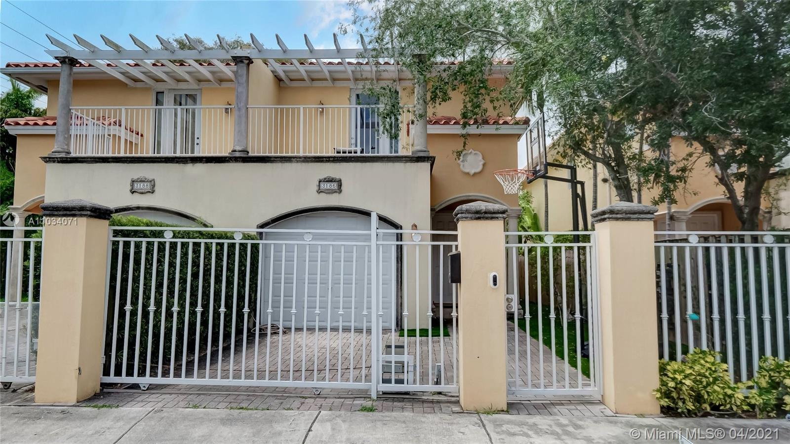 Amazing gated townhouse in the heart of Coconut Grove! This TH features 3BR/2.5B with high ceilings