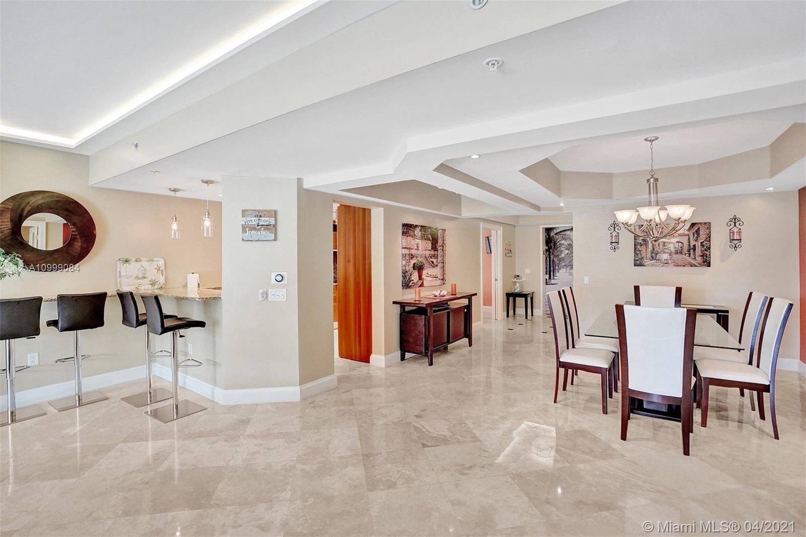 Impeccably designed Mozart model with upgrades galore steps away from the ocean. Elevator opens dire