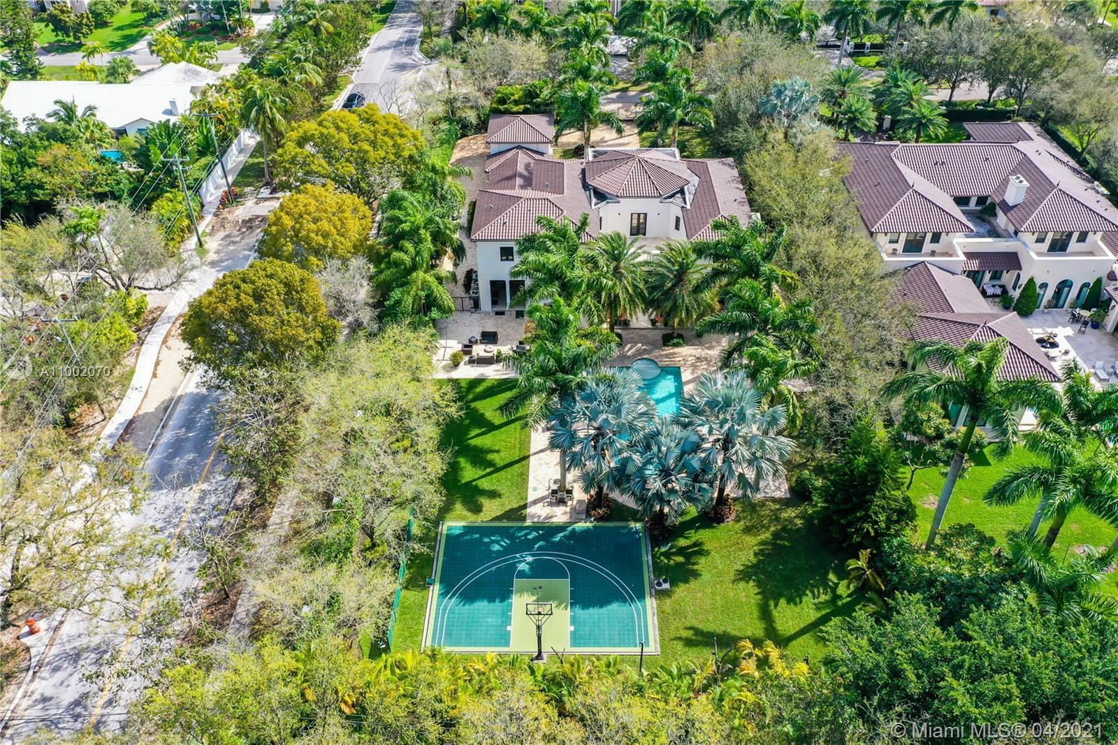 A stunning Mediterranean  Single Family Home is like a dream come true. Located in Pinecrest premier